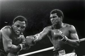Muhammed Ali in one of his many battles with Joe Fraizer. (creative commons photo)