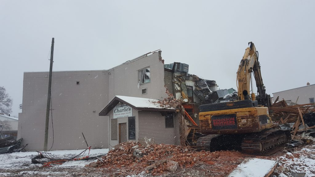 An excavator tears into the Good Time Charlie's building as part of the demolition process. (City Times Photo)