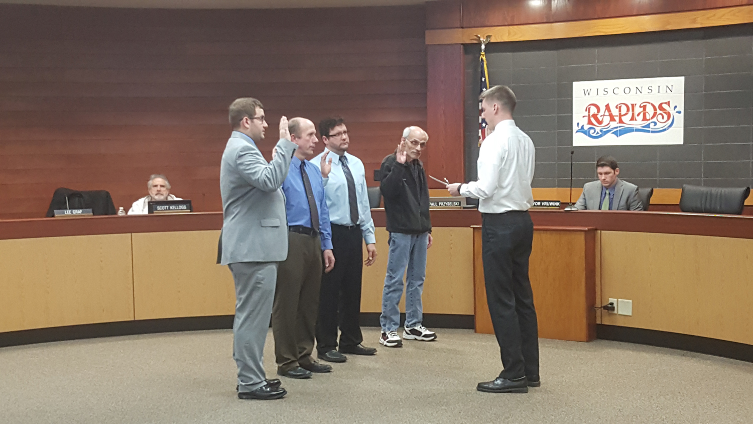 From left to right: Jake Cattanach, Shane Blaser, Lee Graf, and Tom Rayome -- sworn in by city clerk Paul Przybelski. (City Times Photo)